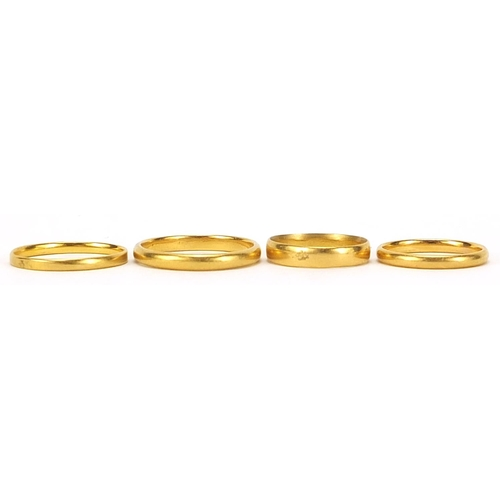 700 - Four 22ct gold wedding bands, Birmingham 1928 size J, Birmingham 1936 size R, London 1951 size N, an...