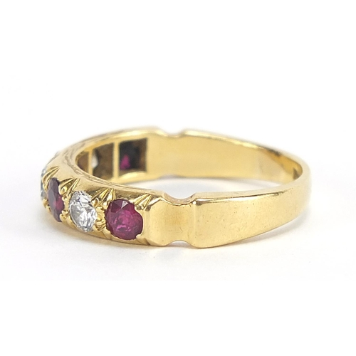 53 - 18ct gold diamond and ruby half eternity ring, the diamonds approximately 3.2mm in diameter, size R,...