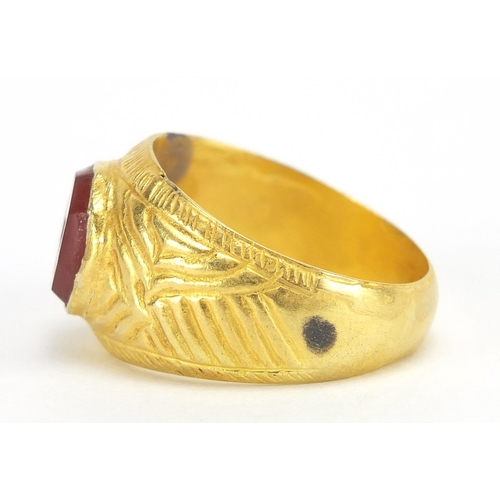 16 - Antique unmarked gold intaglio seal ring carved with a horse, (tests as 15ct+) size U, 5.6g