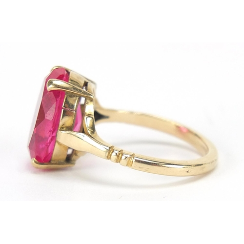 34 - Unmarked gold ruby solitaire ring, the stone approximately 14.5mm x 10mm x approximately 6mm deep, 4...