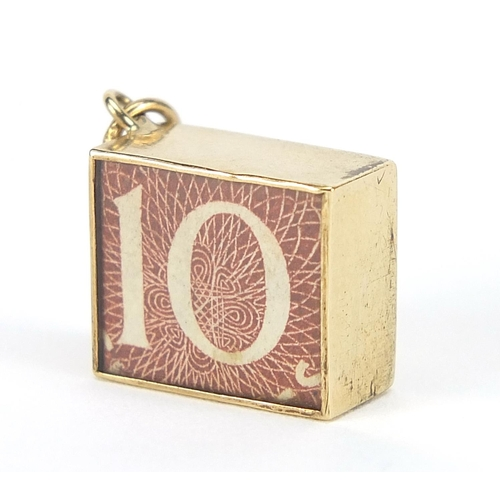 9ct gold emergency ten shilling note charm, 1.4cm wide, 2.4g