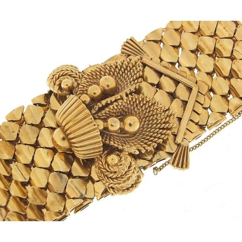 11 - Large 9ct gold belt and buckle design bracelet with floral basket design clasp, S & SLD maker's mark...