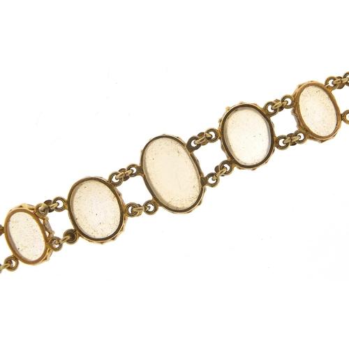 15 - Antique unmarked gold graduated cabochon moonstone bracelet, 13cm in length, 7.6g