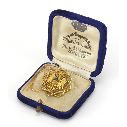 35 - Unmarked gold Polish eagle with crown brooch set with sapphire and diamonds, housed in a Johann Wagn...