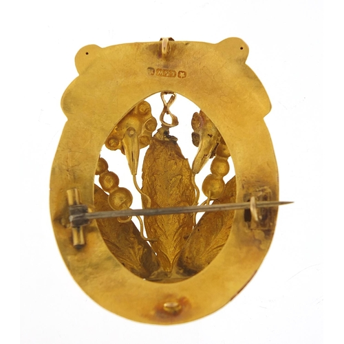 24 - Large unmarked gold naturalistic brooch (tests as 9ct gold) set with green stones, possibly emeralds...
