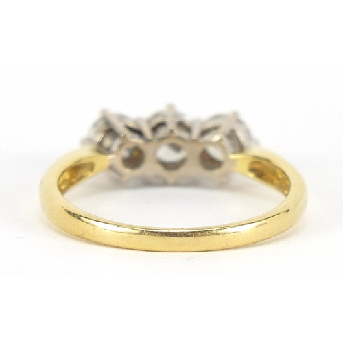 27 - 18ct gold diamond three stone ring, the central diamond approximately 4.2mm in diameter, size O, 3.4...
