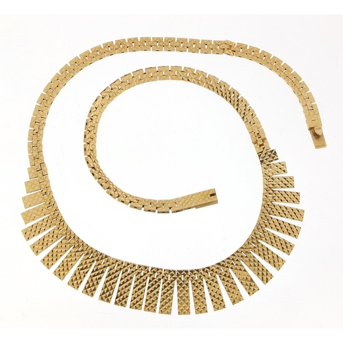 22 - 9ct gold Egyptian design necklace, 43cm in length, 34.0g