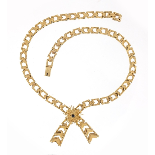 32 - 9ct gold bow design necklace set with a sapphire, 38cm in length, 22.4g