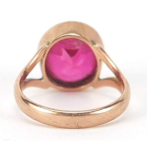 19 - 9ct rose gold ruby solitaire ring, the stone approximately 10mm in diameter, size H, 3.6g
