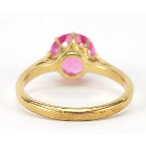 49 - 18ct gold ruby solitaire ring, the stone approximately 8mm in diameter, size N, 3.7g