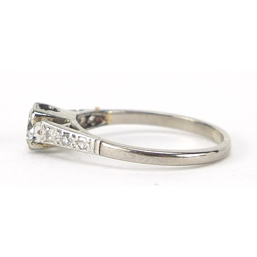 41 - 18ct white gold diamond solitaire ring with diamond shoulders, the central diamond approximately 4mm...