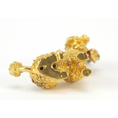 42 - 9ct gold seated poodle charm with ruby eyes, 3cm high, 8.7g