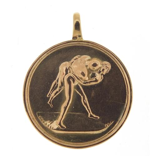 30 - 9ct gold Apollo pendant, 3.2cm in diameter, 5.7g