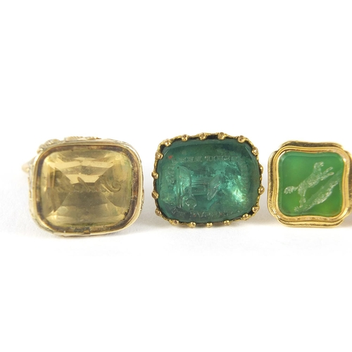 26 - Four Georgian and later unmarked gold and gold coloured metal intaglio seal fobs, the largest 2.3cm ...