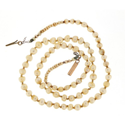 51 - Antique graduated pearl necklace with 9ct gold clasp, housed in a tooled leather box, 42cm in length