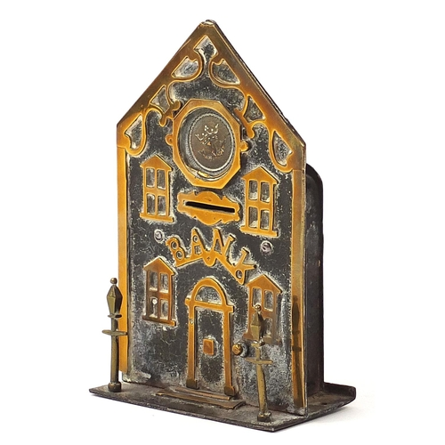 291 - 19th century brass money bank in the form of a building with two lanterns to the exterior, 18cm high