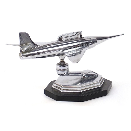 290 - Vintage chrome plated table lighter in the form of a jet aircraft, 24cm in length