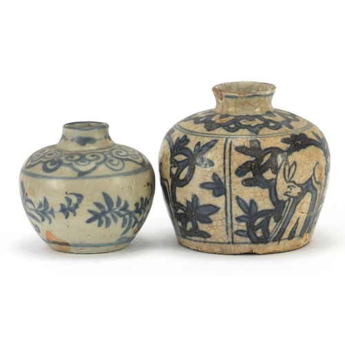 25 - Annamese blue and white porcelain vase hand painted with animals and a similar example, the largest ...