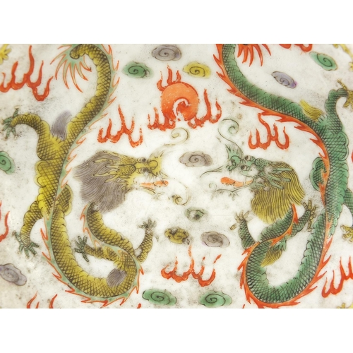 6 - Chinese porcelain dragon dish hand painted in the wucai palette with two dragons chasing a flaming p...