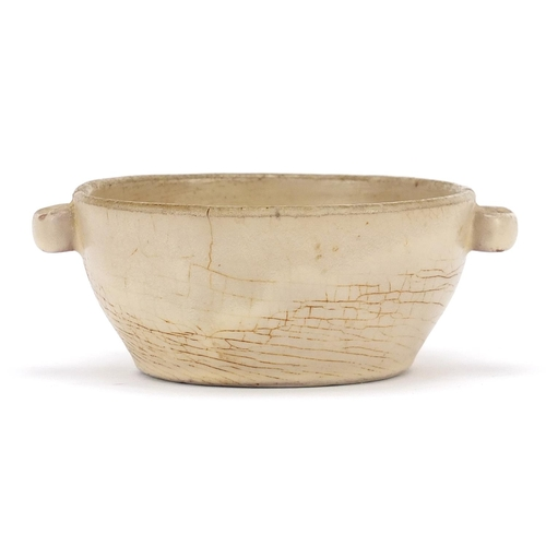23 - Asian celadon glazed bowl with twin handles, possibly Korean or Chinese, 12.5cm wide