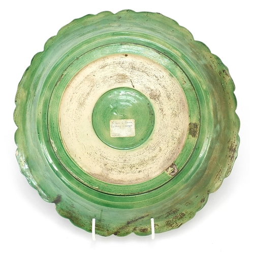 7 - Chinese green and yellow glazed porcelain dish decorated in relief with figures in a palace setting,...