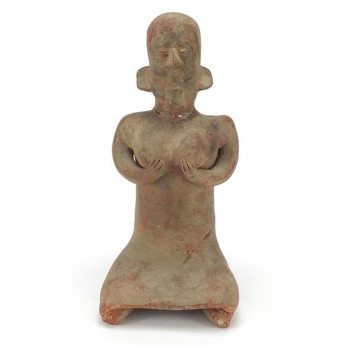 180 - South American pottery figure of a nude figure kneeling, 40.5cm high
