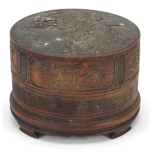 57 - Chinese cylindrical bamboo box and cover finely carved with a landscape, 11.5cm high x 16.5cm in dia...
