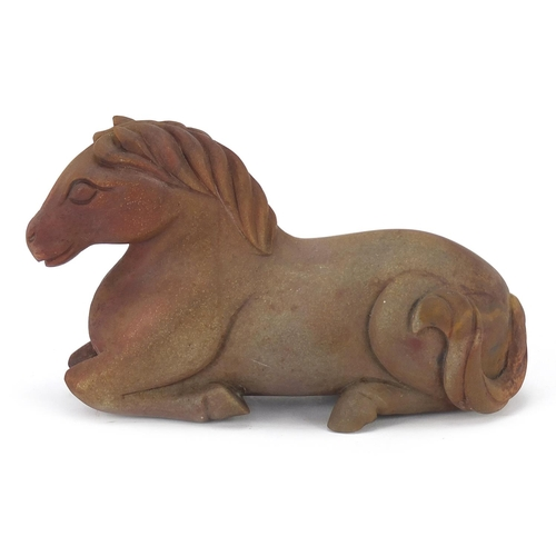 42 - Chinese hardstone carving of a recumbent horse, possibly jade, 15.5cm in length