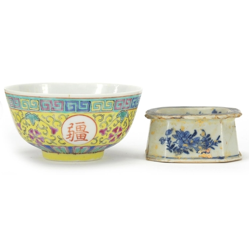 17 - Chinese porcelain comprising a Canton wrist rest, blue and white salt and a famille rose bowl, the l...