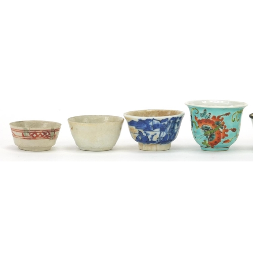 13 - Seven Chinese porcelain tea bowls, including four blue and white examples, the largest 3.5cm high