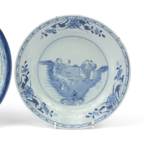 15 - Three Chinese blue and white porcelain plates hand painted with figures and pagodas, the largest 25c...