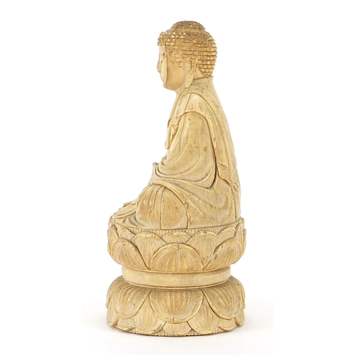37 - Chinese ivory carving of seated Buddha, character marks to the base, 11cm high