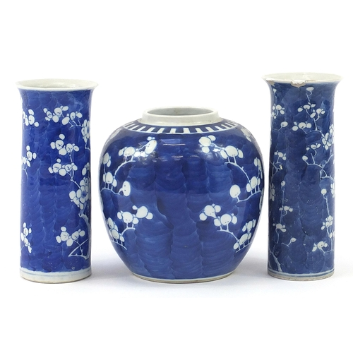19 - Chinese blue and white porcelain hand painted with prunus flowers comprising two cylindrical vases a...