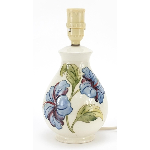 396 - Moorcroft magnolia baluster table lamp, paper label to the base, 27cm high