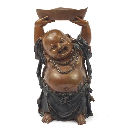 117A - Large Chinese patinated bronze figure of Buddha with his hands above his head holding a vessel, 48cm...