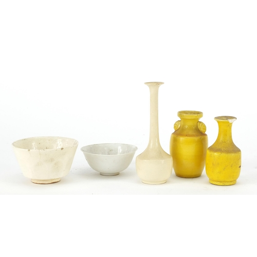 16 - Chinese porcelain comprising two yellow vases, blanc de chine bowls and blanc de chine vase, the lar...
