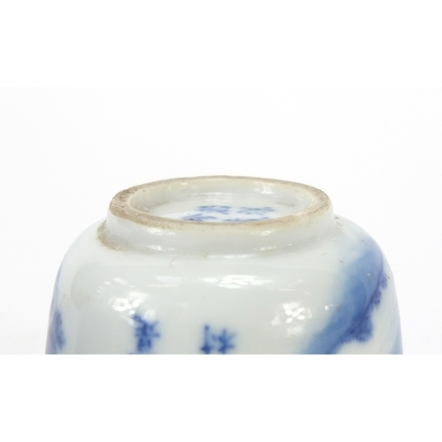 12 - Pair of Chinese blue and white porcelain tea bowls, each hand painted with a figure on buffalo back ...