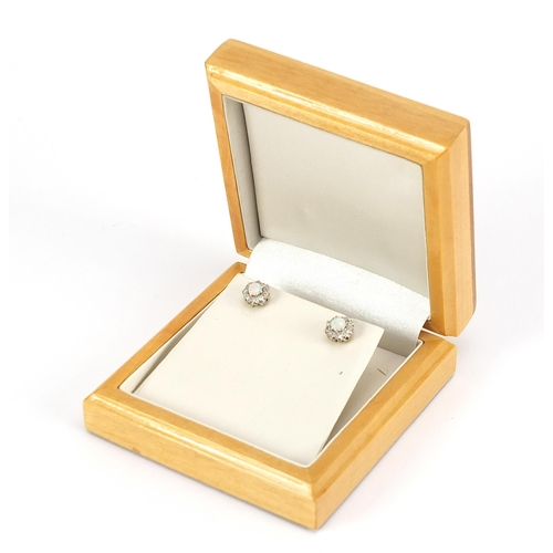 1672 - Pair of 18ct gold opal and diamond stud earrings, 8mm in diameter, 2.0g