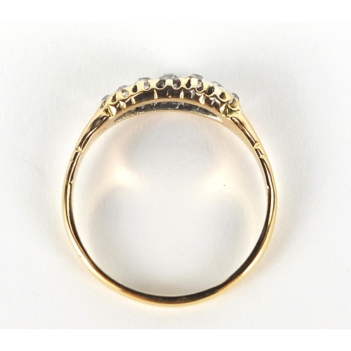 1673 - 18ct gold diamond cluster ring, size Q/R, 2.5g