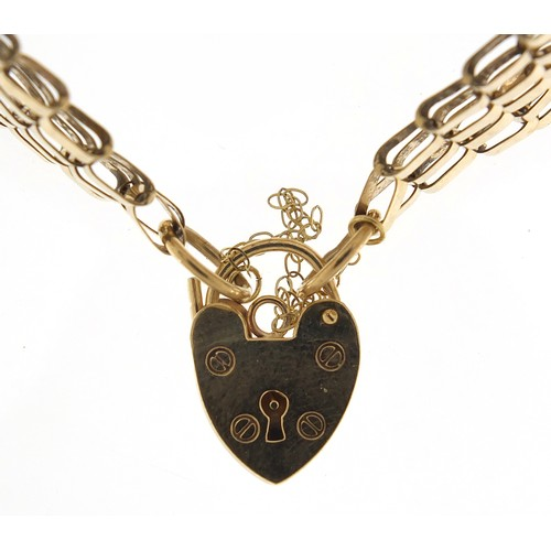 1699 - 9ct gold eight row gate link bracelet with love heart padlock, 18cm in length, 14.5g