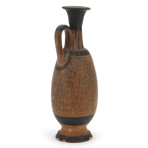 146 - South Italian pottery single handled jug hand painted with a net pattern, 17.5cm high