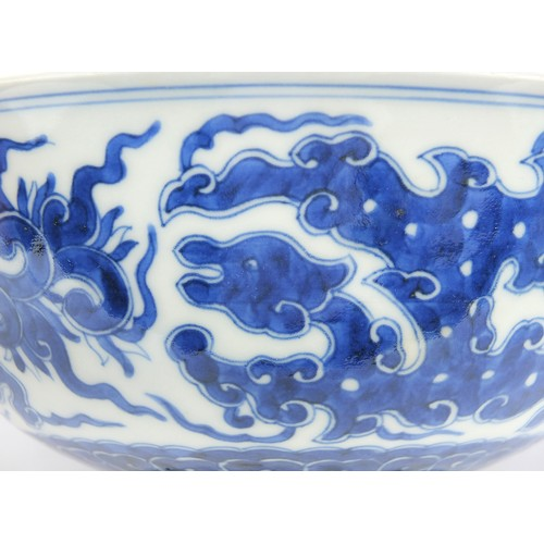4 - Chinese blue and white porcelain footed bowl finely hand painted with mythical animals above crashin...