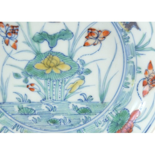 5 - Chinese porcelain doucai dish hand painted with ducks amongst aquatic life, six figure character mar...