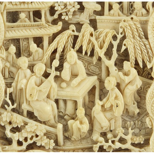 35 - Chinese Canton ivory card case finely and deeply carved with figures amongst pagodas, 10.5cm H x 6.5...