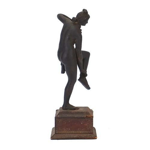 217 - Antique cast metal figure of a nude female raised on a rectangular base with tooled leather mounts, ...