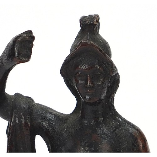 219 - Antique patinated bronze figure of a nude figure with robe, raised on a square black slate base, pos...