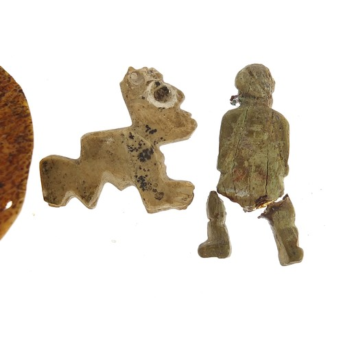 175 - Antiquities including a carved bone face mask, the largest 4cm high