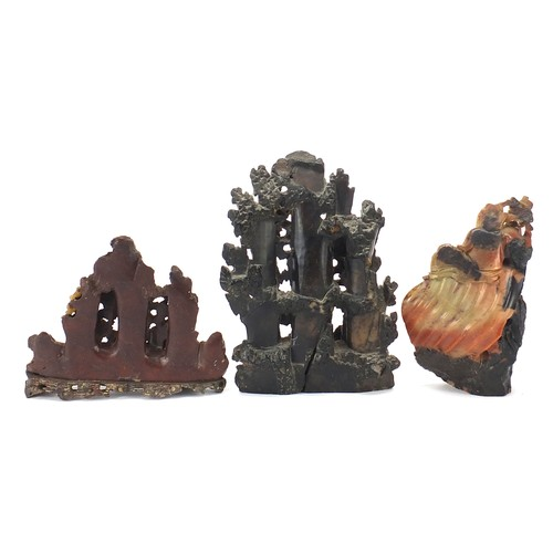 48 - Three Chinese soapstone landscape carvings including one of two immortals amongst clouds, the larges...