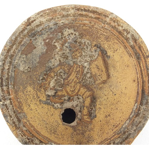 172 - Roman terracotta oil lamp decorated in relief with a figure, 9cm in length