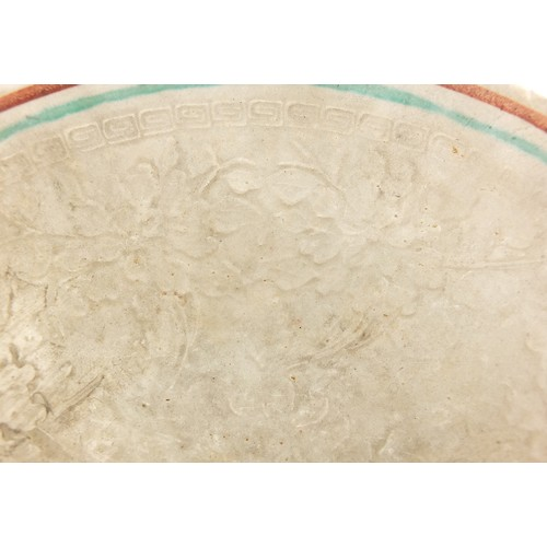 24 - Unusual Chinese porcelain bowl finely decorated in relief with flowers, painted character marks to t...